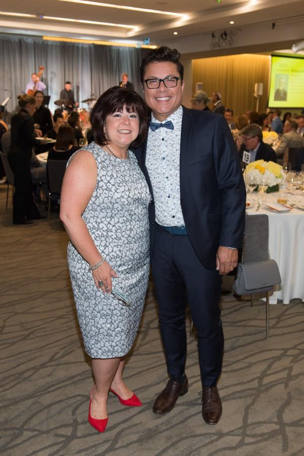 executive director poses for camera at gala with her husband