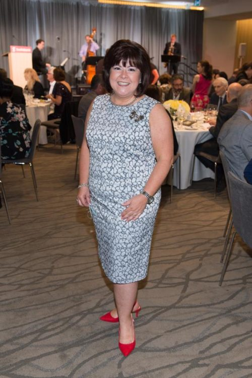 executive director poses for camera at gala
