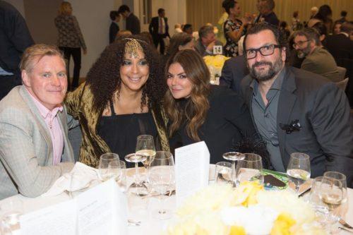 group of guests at table at gala
