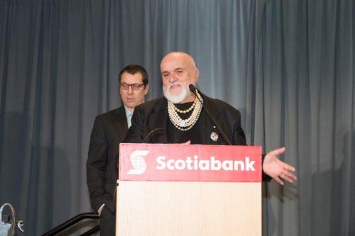past honouree speaking at podium