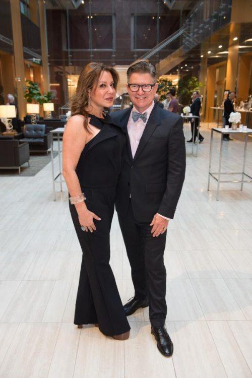 honouree and man pose for camera at gala