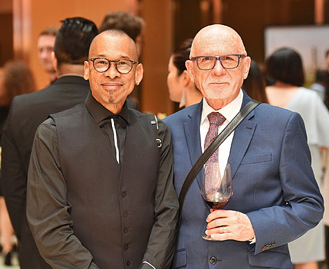 two men posing for camera at gala
